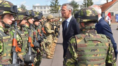 NATO Secretary General Jens Stoltenberg inspects troops