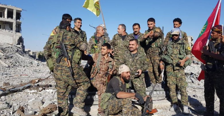 SDF and YBS fighters celebrate in Raqqa
