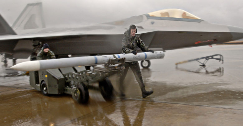 M120 AIM-9 missile and an F-22A Raptor