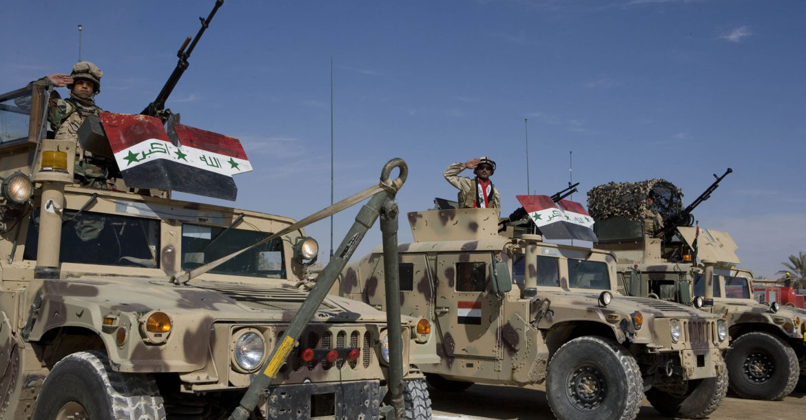 Iraqi Security Forces salute from Humvees