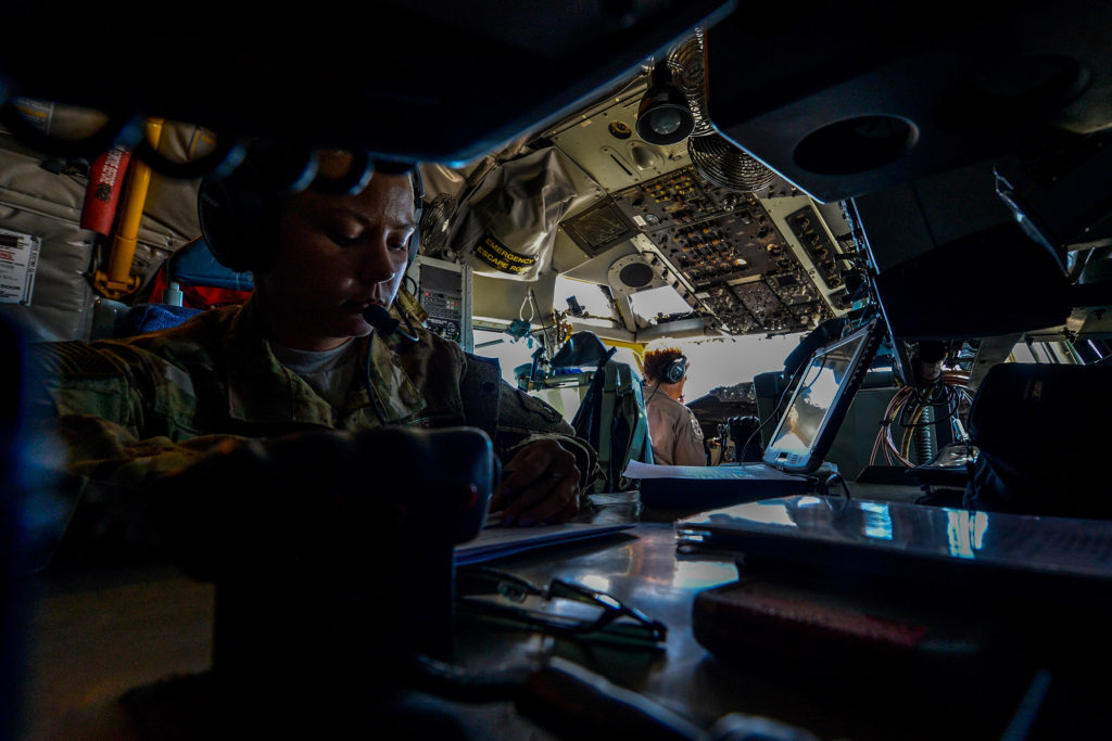 USAF boom operator reviews refueling documents