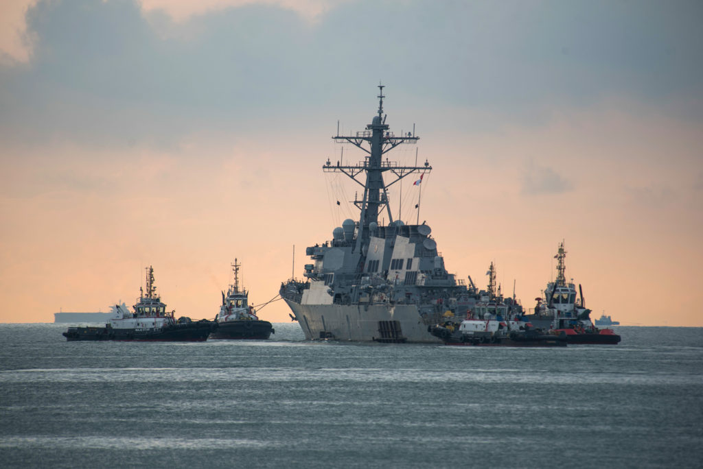 USS John S. McCain towed for transport