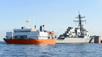USS Fitzgerald is loaded on a transport ship for final repairs