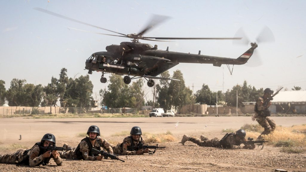 Iraqi special operations forces provide security for a helicopter
