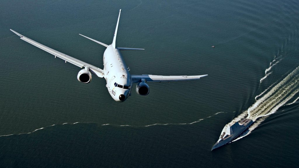 P-8A Poseidon flies over USS Zumwalt