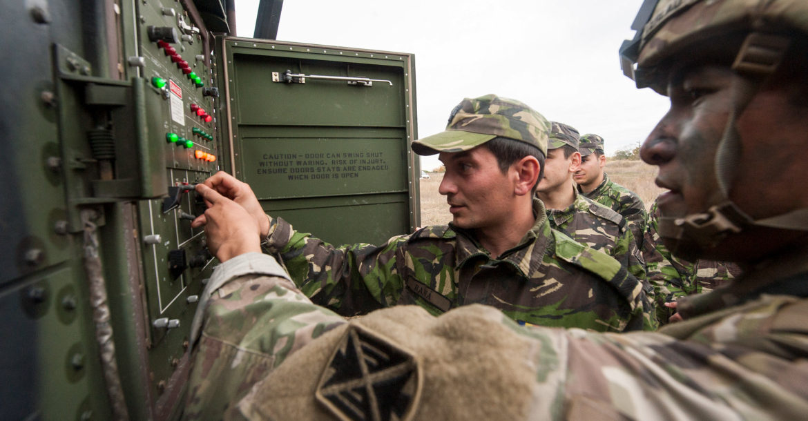 Romanian and US troops reposition a Patriot air defense missile launcher