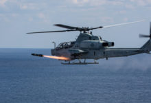 AH-1Z Viper attack helicopter fires a Hellfire missile