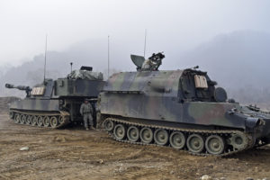 M992A2 Field Artillery Ammunition Supply Vehicle resupplies an M109A6 Paladin howitzer