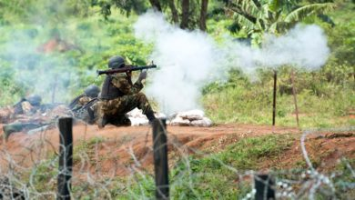 Ugandan People's Defence Force soldier fires an RPG