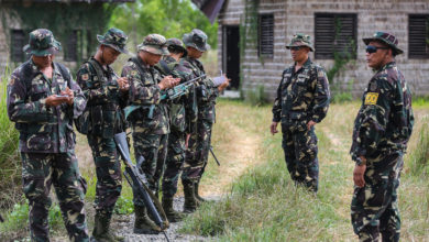 Philippine Army Tech. Sgt. Rernaur Bwenaia, an Explosive Ordnance Disposal (EOD) technician, instructs Philippine Army Soldiers from the 20th Infantry Battalion how to identify improvised explosive devices