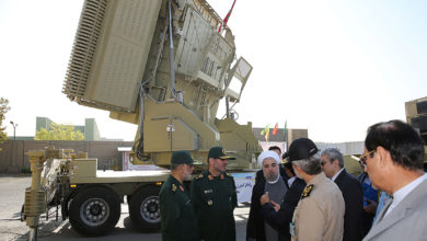 Iran's President Hassan Rouhani with the Bavar-373 air defense missile system