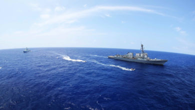 The Chinese Navy guided-missile destroyer Xi'an (153) participates in a maritime interdiction event with the guided missile destroyer USS Stockdale (DDG 106), during Rim of the Pacific (RIMPAC) 2016.