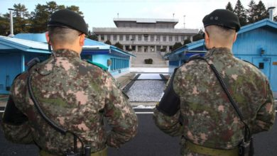 South Korean soldiers guard the DMZ dividing the two Koreas