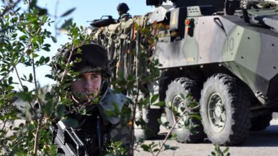 A Spanish marine performs security while conducting convoy training during Exercise LISA AZUL