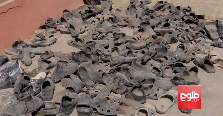 Shoes of victims of an Afghan Air Force airstrike at a religious school in a Taliban-controlled part of Dasht-e-Archi, Kunduz province