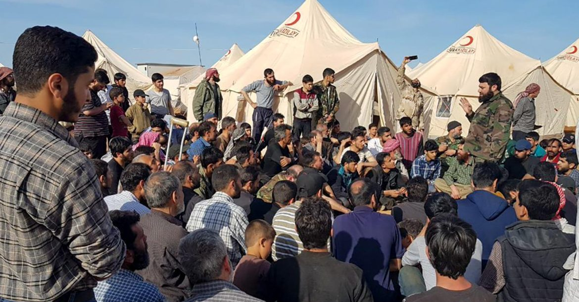 Jaysh al-Islam leader Issam Buedany at an IDP camp in Jarablus