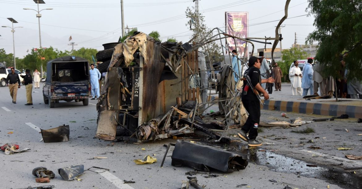 Pakistani security officials inspect a police truck after a bomb blast in in Quetta on April 24, 2018