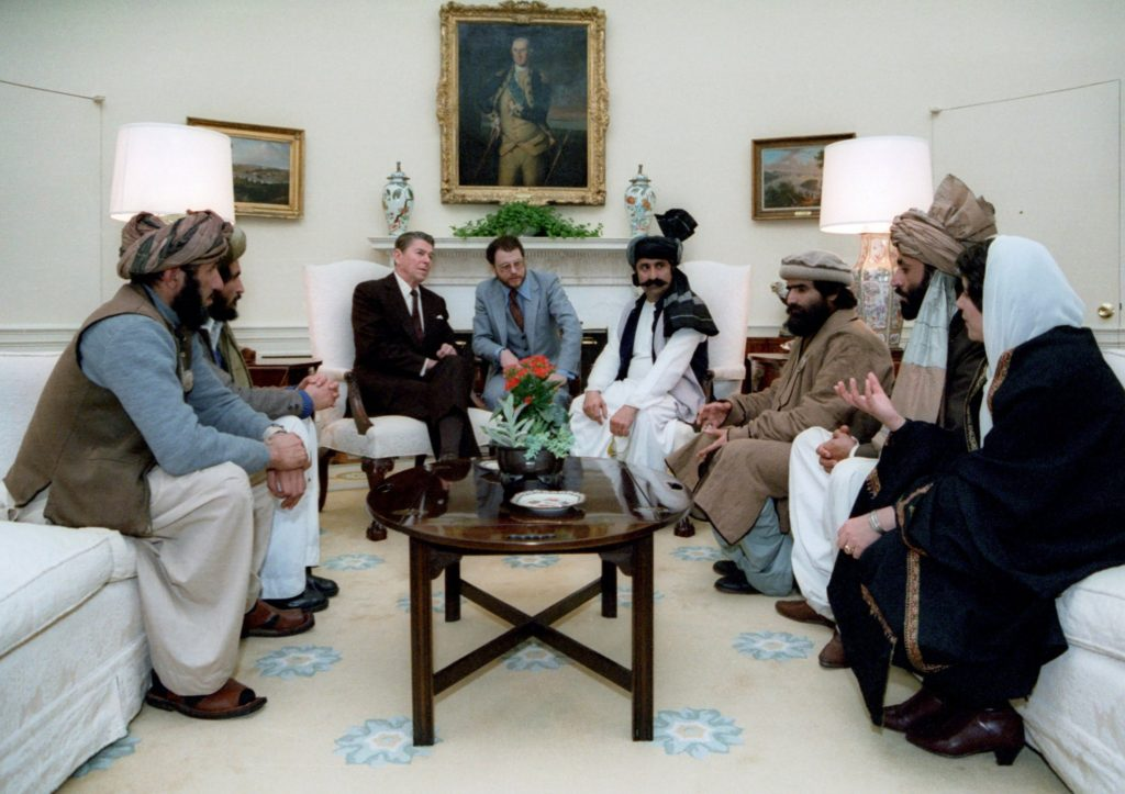 US President Reagan meeting with Afghan Mujahideen in the Oval Office to discuss the Soviet occupation of Afghanistan