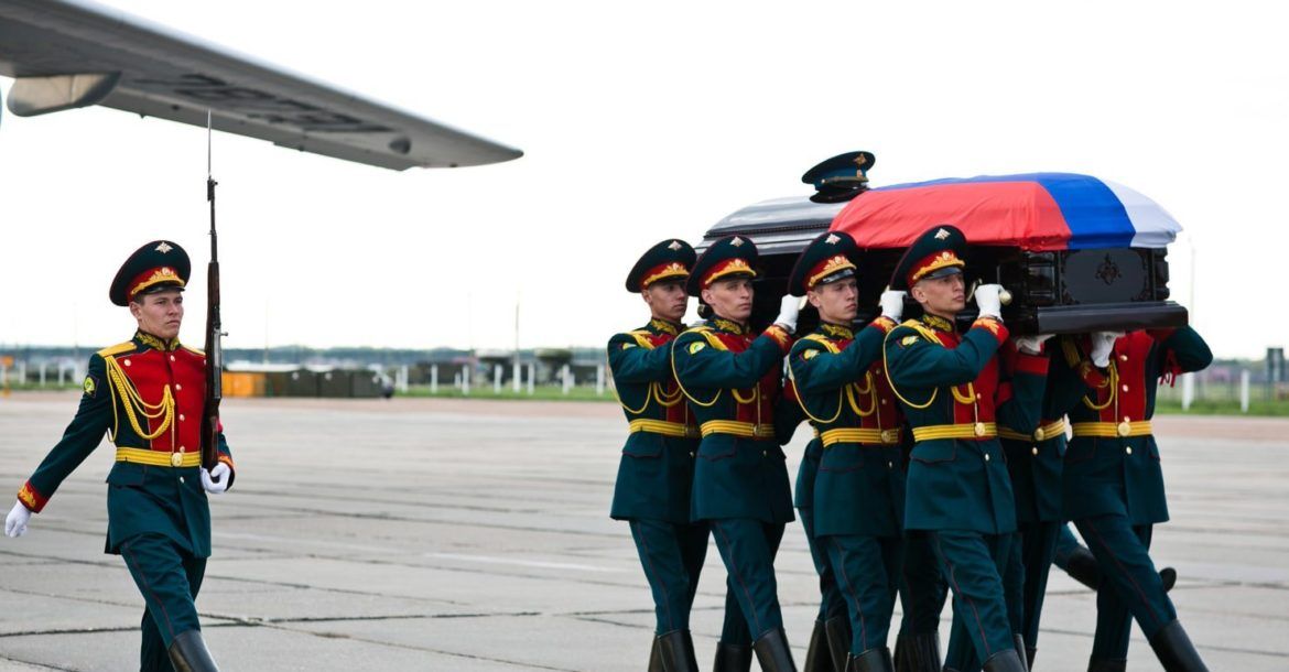 Casket of a Russian soldier is carried from a plane