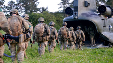 UK troops board Chinook helicopter