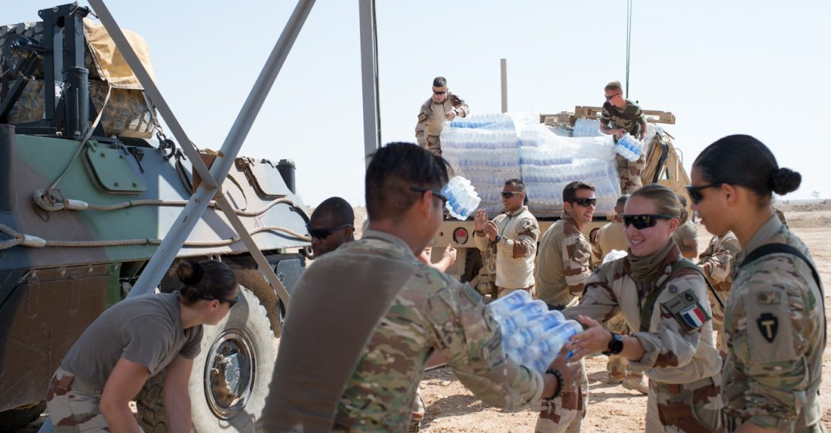 French and American forces offload supplies in Syria's Euphrates River Valley in May 2018