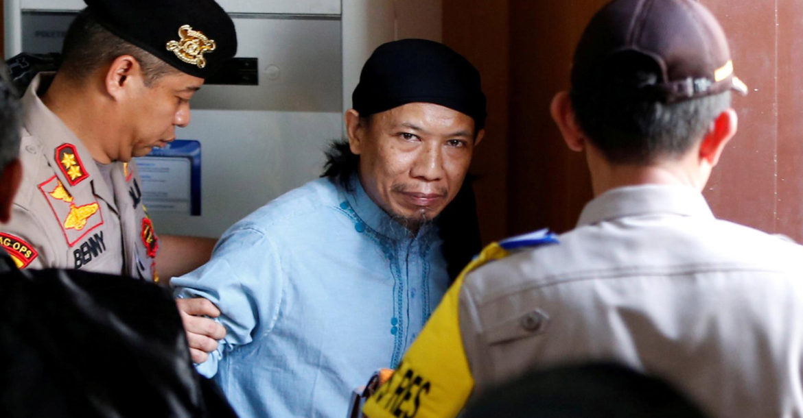 Indonesian cleric Aman Abdurrahman leaves court after death sentence