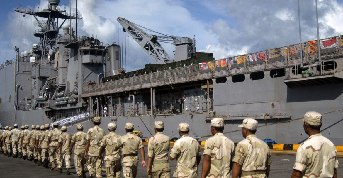 Royal Cambodian Marines embark aboard the amphibious dock landing ship USS Tortuga