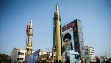A display featuring missiles and a portrait of Iranian Supreme Leader Ayatollah Ali Khamenei is seen at Baharestan Square in Tehran on September 27, 2017.