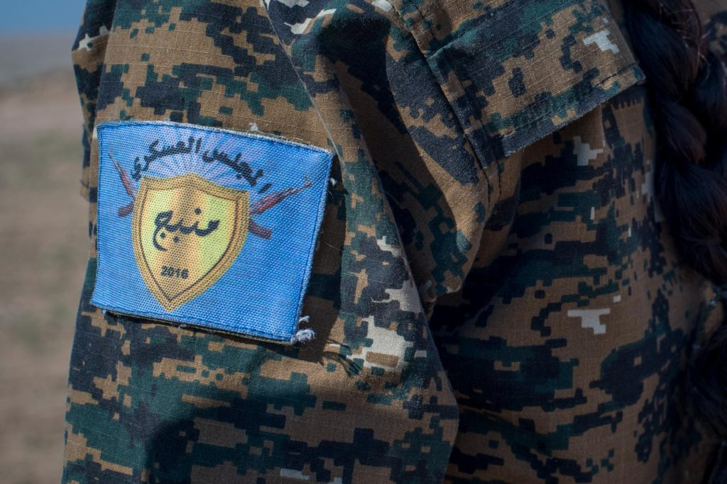Local female Manbij Military Council trainees learn marksmanship training