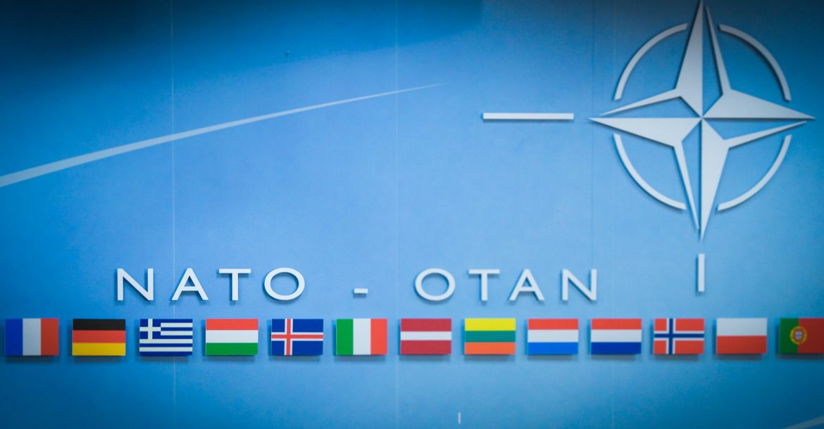 NATO flag backdrop