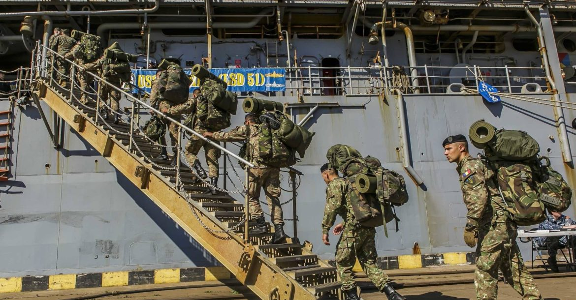 Romanian 307th Naval Infantry Battalion embarks with 26th MEU Marines aboard USS Oak Hill