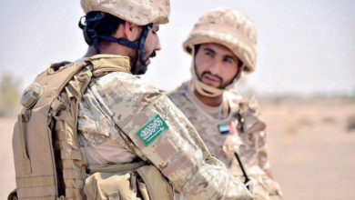 Saudi Arabia soldier talks to UAE soldier