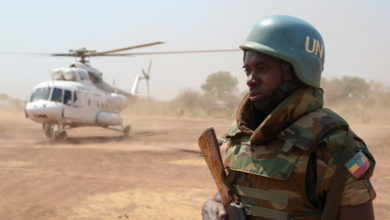 Ethiopian UNMISS peacekeeper guards helicopter