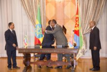 Ethiopian Prime Minister Abiy Ahmed (left) and Eritrean President Isaias Afwerki (right) hug after signing a Joint Declaration of Peace and Friendship at the state house in Asmara, Eritrea