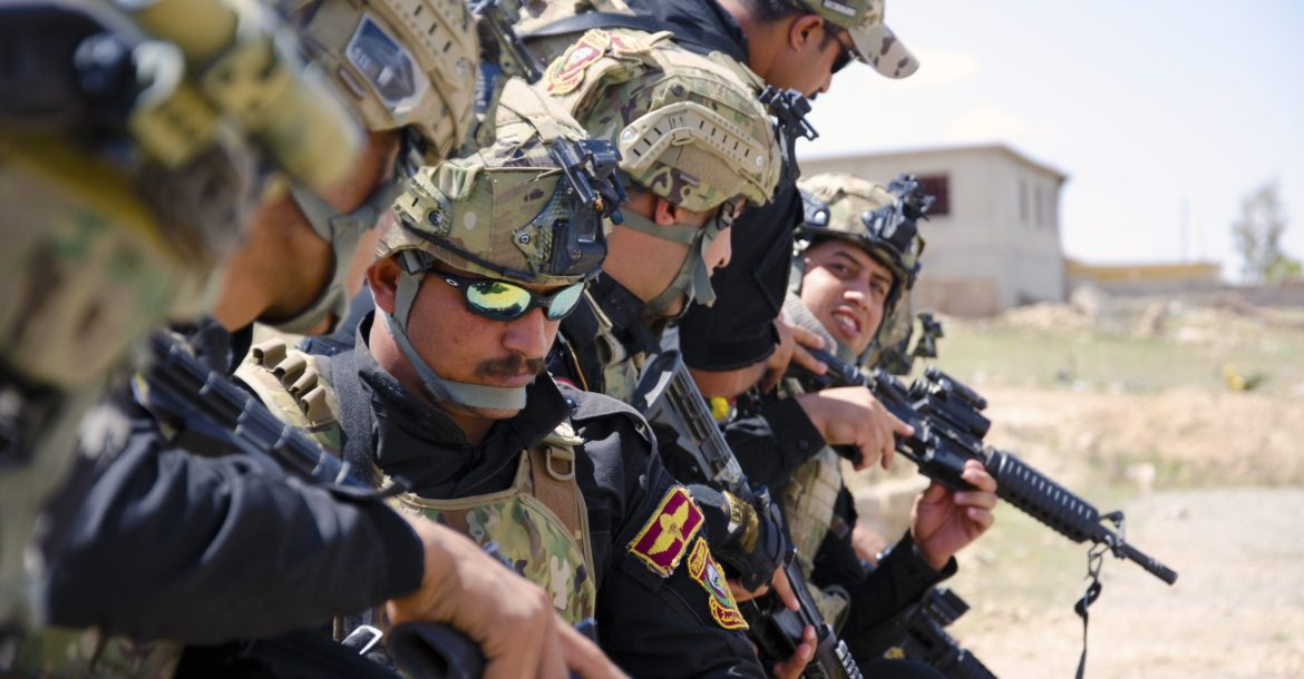 Iraqi Counter Terrorism troops inspect their weapons before conducting a cordon and search training exercise outside Mosul, Iraq