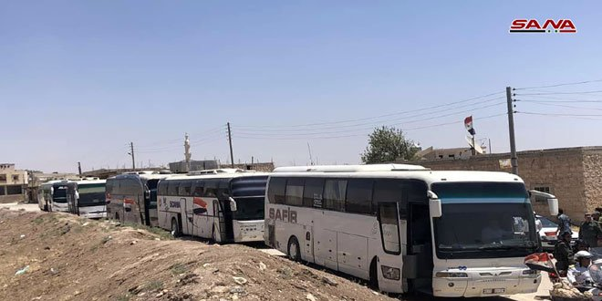 Buses enter the towns of Foua and Kafriya in Syria's Idlib province to evacuate residents to government-held territory.