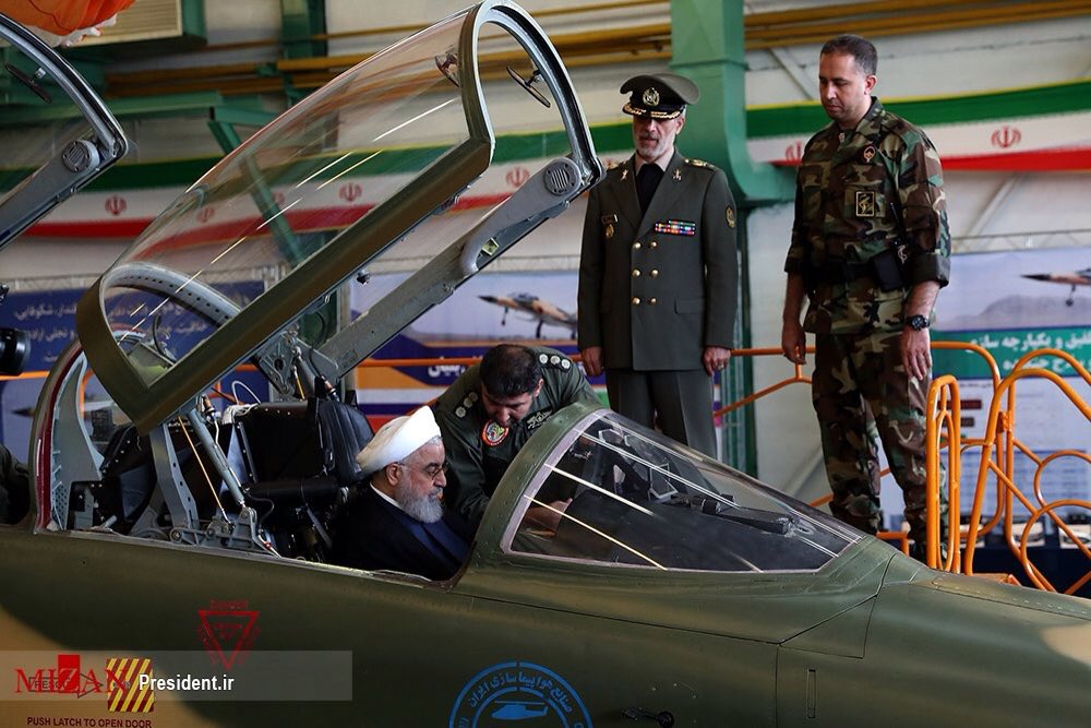 Iranian President Hassan Rouhani sits in the cockpit of the 'Kowsar' fighter jet