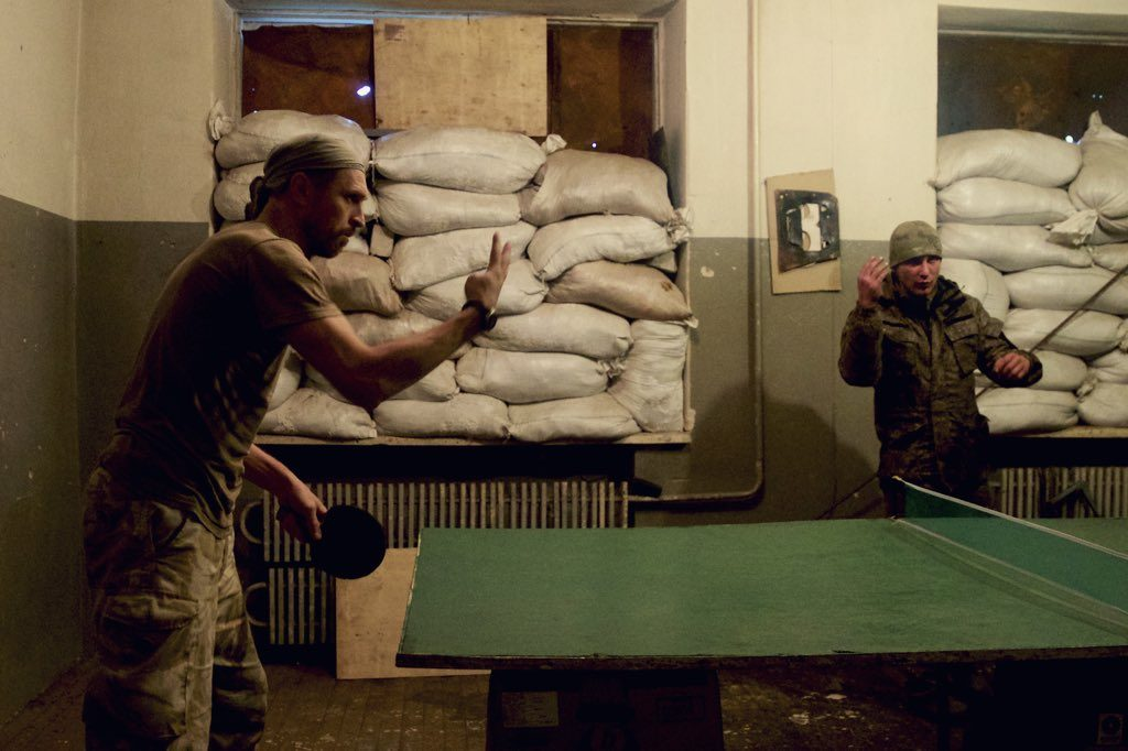 Ukrainian soldiers play table tennis at a frontline base in Avdiivka, Ukraine