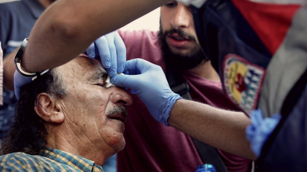 An old man is wounded after stun grenades and rubber bullets are fired into a crowd of Palestinians in East Jerusalem, Israel/Palestine
