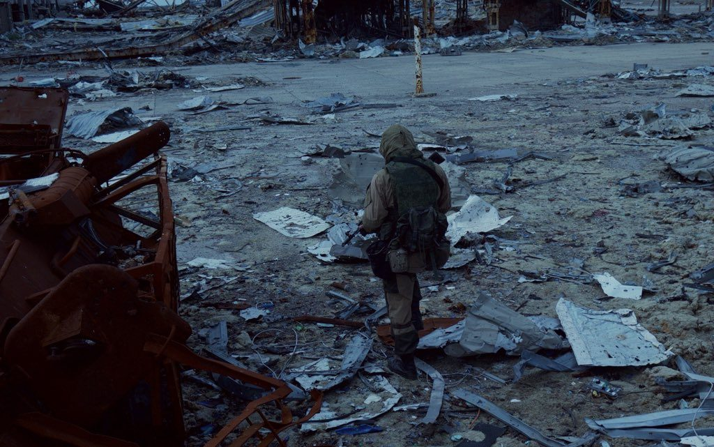 A separatist fighter of the Sparta Battalion walks through the debris of Donetsk Airport, Ukraine