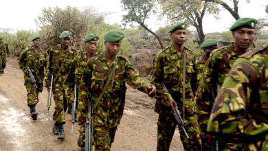 Kenya military personnel march in Nginyang Village