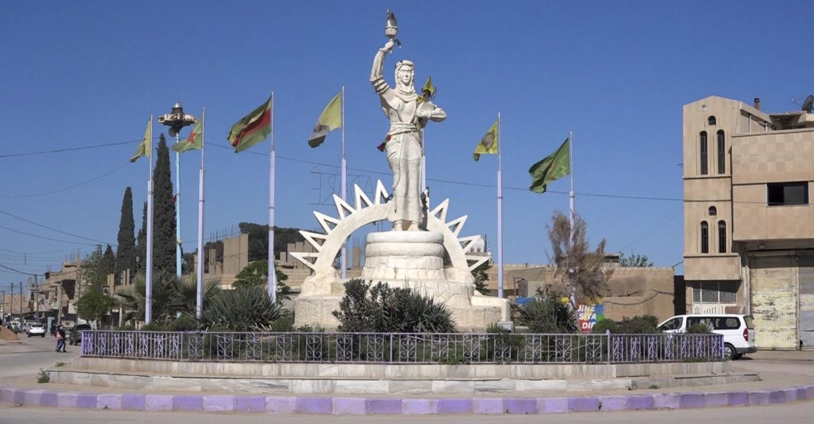 The Statue of the Free Woman at the entrance of Amude, 20 miles west of Qamishli, Syria