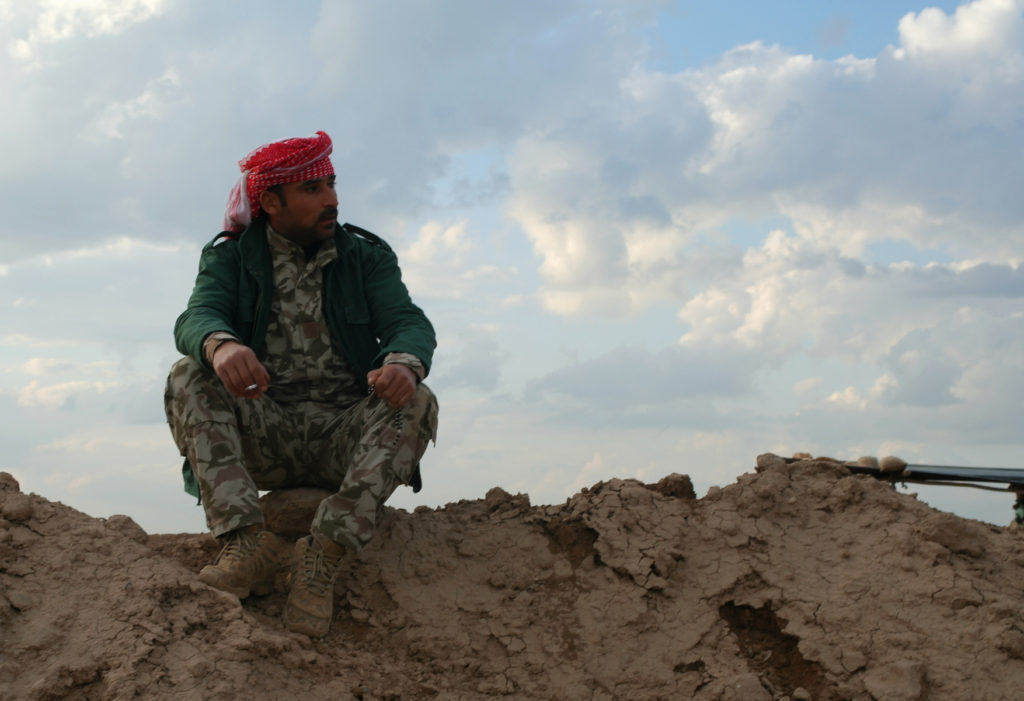 Peshmerga takes a cigarette break on the Gwer frontline in Iraq