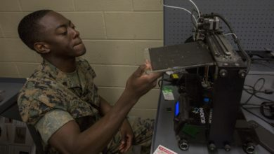 A U.S. Marine demonstrates how to use a 3d printer