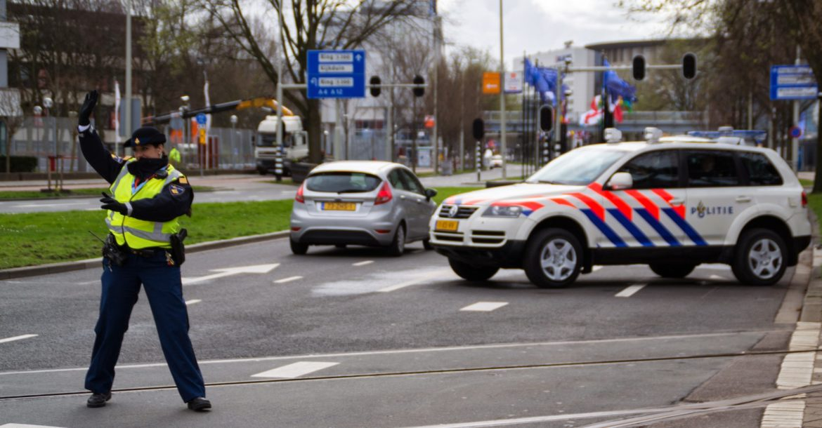 Dutch police officer regulates traffic at 2014 Nuclear Security Summit in the Netherlands