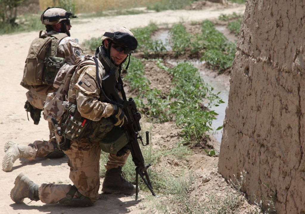 Soldiers from the Czech Republic provide security during a route clearance mission in the Baraki Barak district of Logar province, Afghanistan