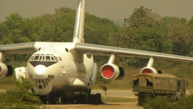 Ilyushin-76 aircraft off-loading ammunition crates in Juba