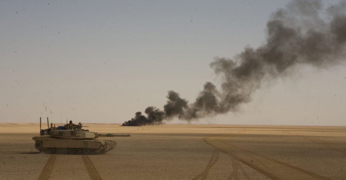 Chemical barrels are set ablaze by the Marines of 1st Tank Battalion during an operation outside Rawah, Iraq