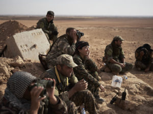 Rojda Felat surveys a flank of Tal al-Samam with other SDF commanders
