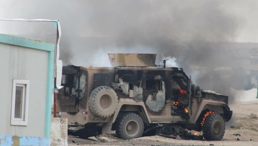 Aftermath of a vehicle bomb at an SDF checkpoint in Shaddadi in Syria's Hasakah governorate